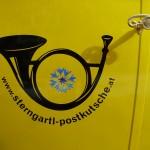 """""""Alt"""" trifft """"Neu"""" bei dem Logo der Sterngartl-Postkutsche, ein traditionelles Posthorn mit der Kornblume der Sterngartl-Region in dessen Mitte und unserer Internet-Adresse."""